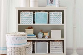 Monogramed canvas storage bins in bookcase