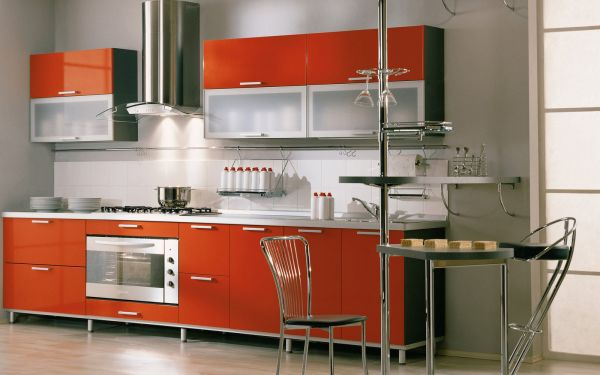 View in gallery Orange modern kitchen with stylish glass cabinets