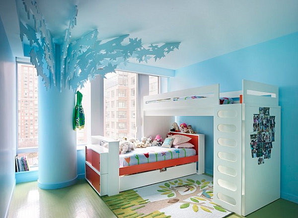 Orange pops in a pastel blue bedroom