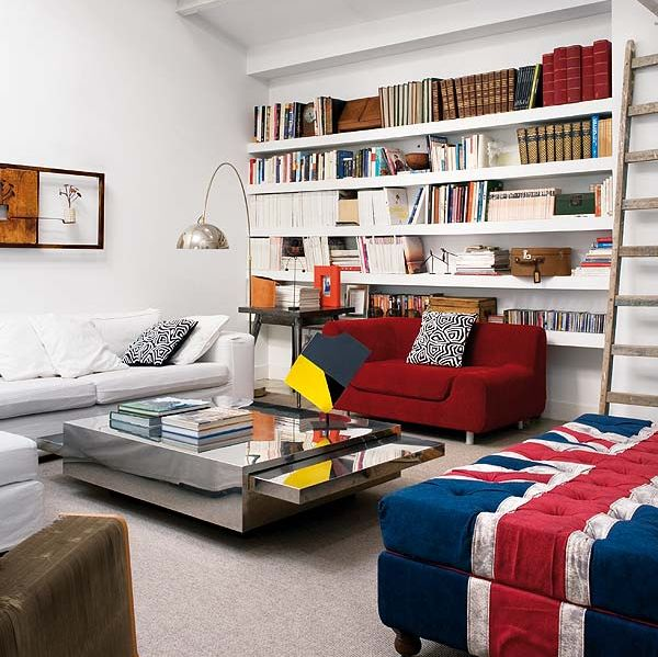 Ottoman in Union Jack colors ideal for a modern home library