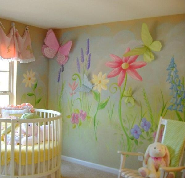 Oversized flowers and lovely wall art make this a vivacious nursery