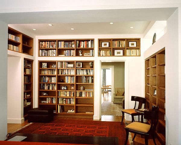 Photographs on wooden bookshelves