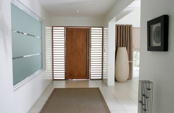 Place an imposing floor vase at the entry way to fill up the awkward corner