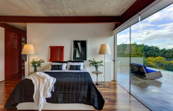 Plush bedrooms with large glass windows