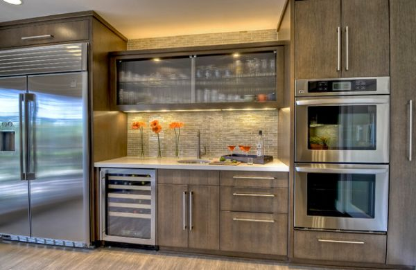 Reeded glass cabinet in the center offers textural contrast in this kitchen space