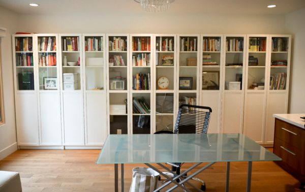 Simple and sleek bookshelf design with glass doors for the home office