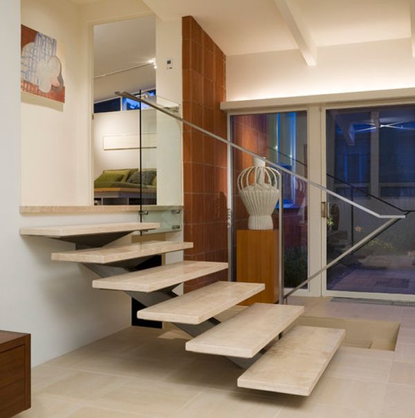 Simple metal railing complements the floating stairway perfectly