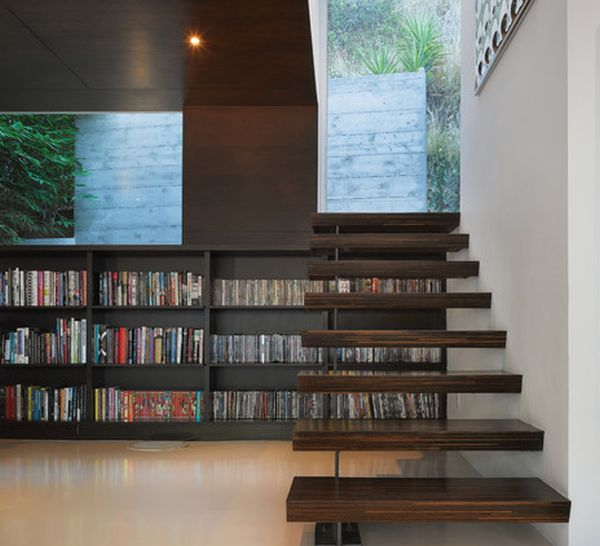 Sleek and stylish floating stairs connect the home with the backyard