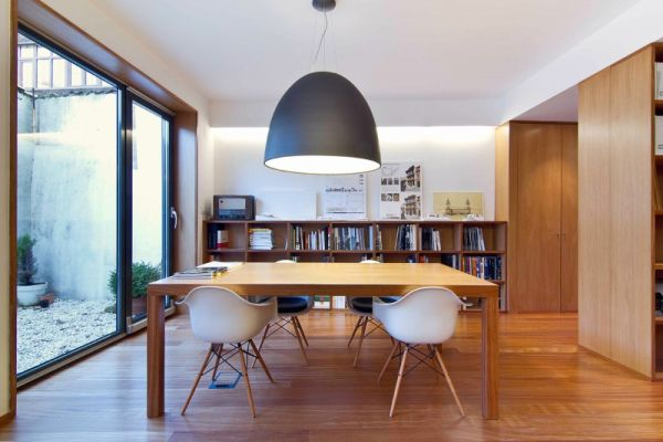 Sliding glass doors keep the interiors connected with the surroundings