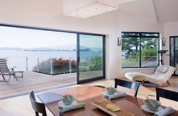 Sliding glass doors offer fresh air and a gorgeous view to enjoy from your chaise lounge