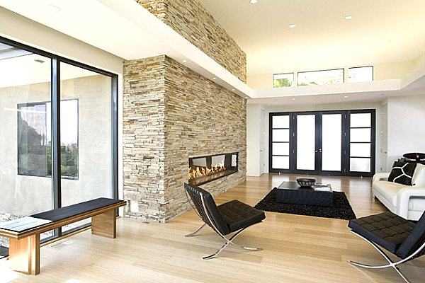 Stone fireplace enclosed in glass