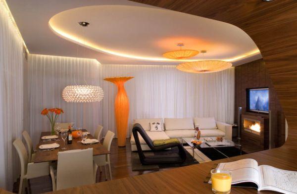 Stunning orange floor vase takes center stage here!