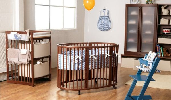 Stylish nursery space looks refined thanks to the circular crib at its heart