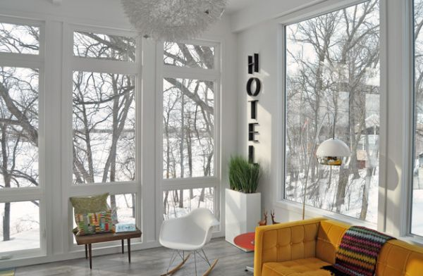 Sun-room in white with a floor vase that blends in seamlessly