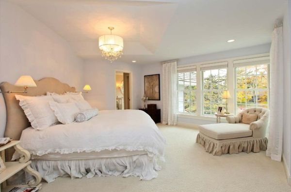 Traditional bedroom with a plush chaise lounge chair