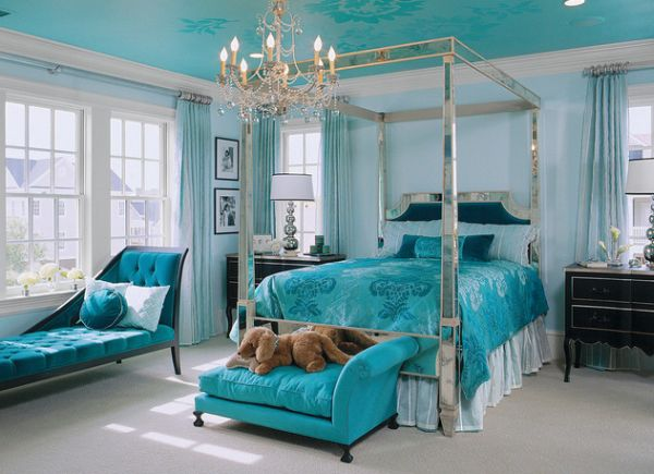 Turquoise bedroom sports a daft chaise lounge next to the window