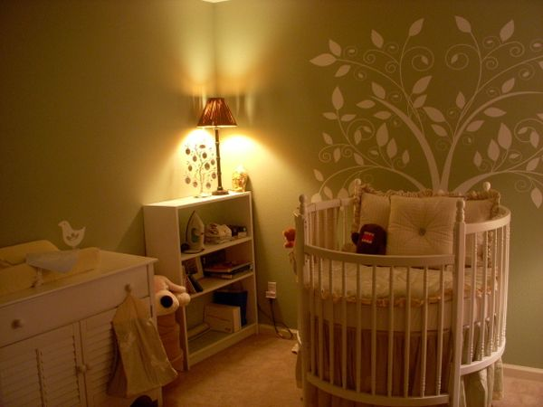 Warm hues and gorgeous wall art add to the beauty of this nursery