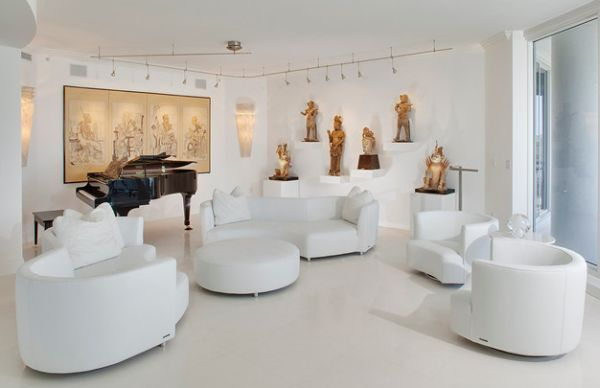 White contemporary setting with track lighting that brings in a museum feel
