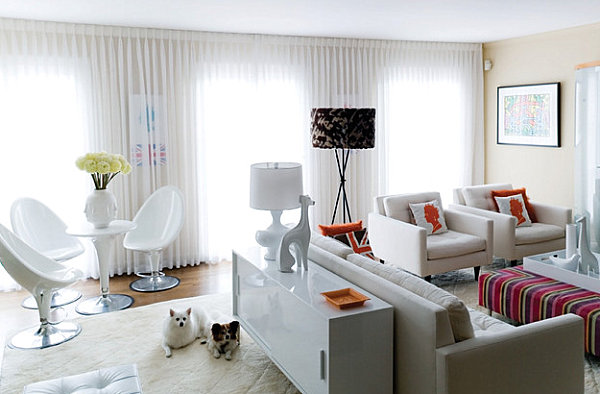 White lacquered furniture in a playfully sophisticated living room
