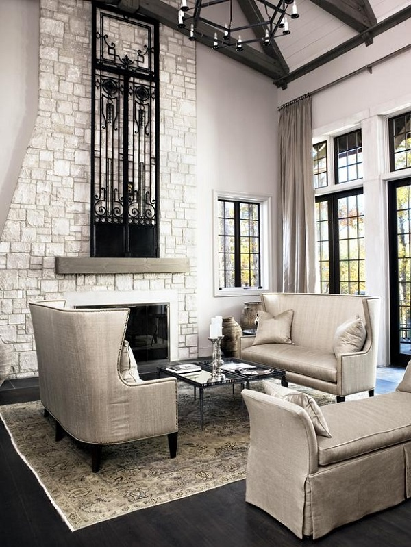 White stone fireplace with cast iron door