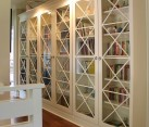 X motif custom designed glass doors give these bookcases an inimitable look
