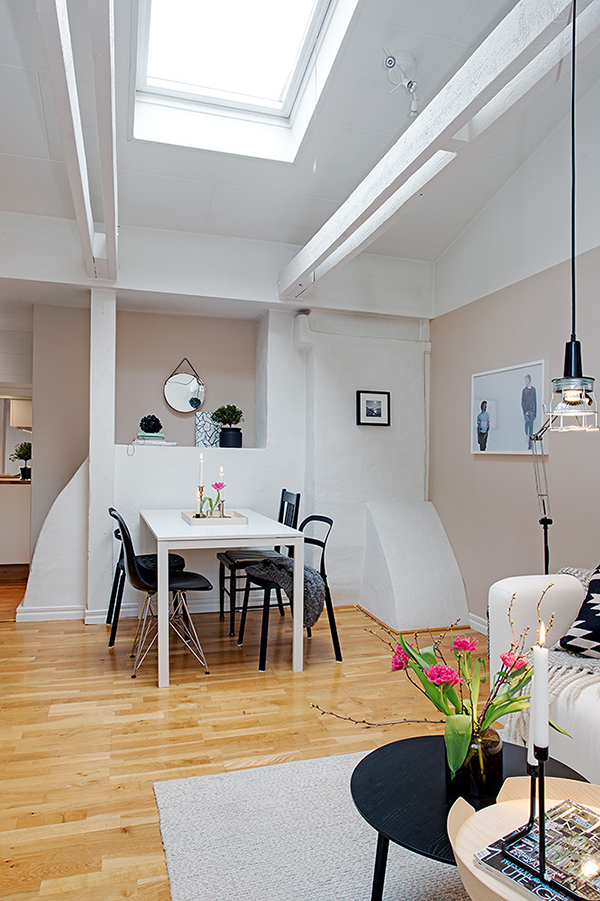 attic apartment design Stockholm Attic Apartment Blends Scandinavian Ease With Elegant Interiors