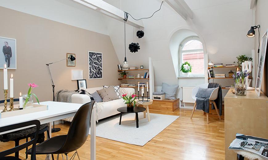 Stockholm Attic Apartment Blends Scandinavian Ease With Elegant Interiors