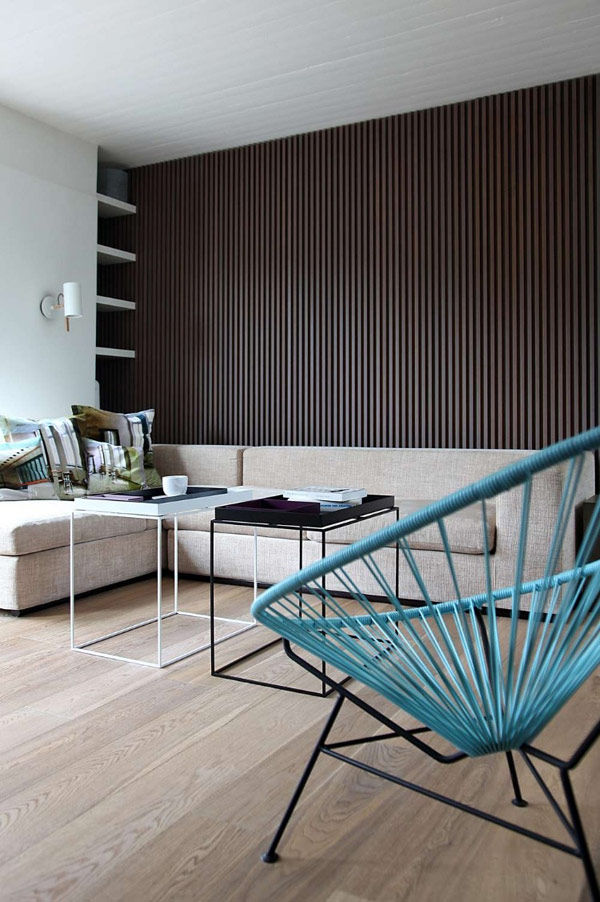 living room couch and wire chairs