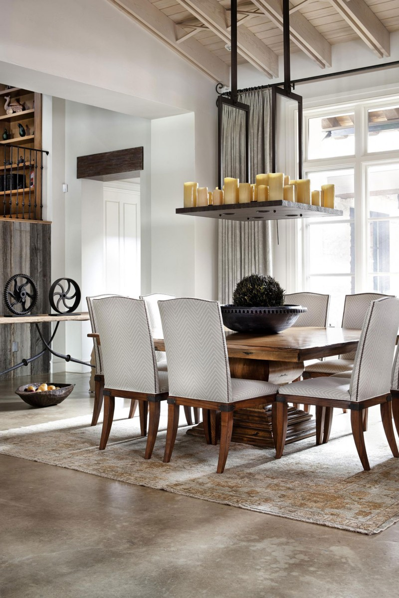 Rustic texas home with modern design and luxury accents for Modern dining room table decor
