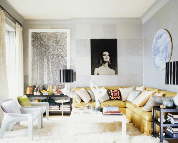 A black lampshade stands out in the living room with an all-white backdrop