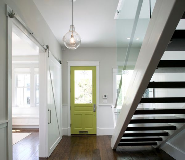 Add drama to the entry way with a green door set in a neutral background