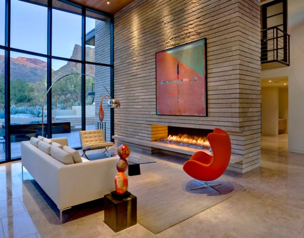 An egg chair in vibrant hues next to a modern fireplace seems to be a pretty popular choice!