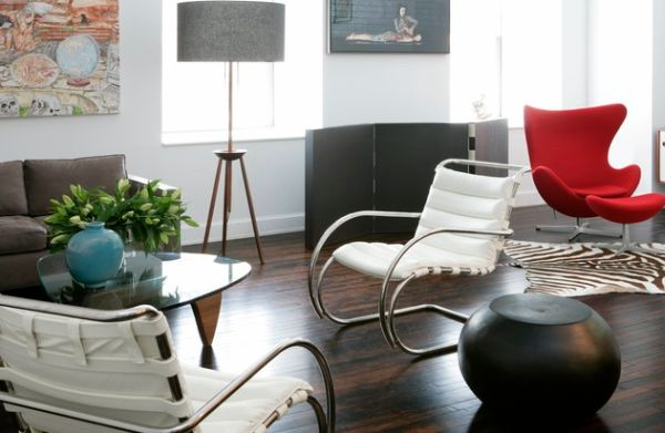 Arne Jacobsen's Egg chair in red steals the show in this white and brown living room