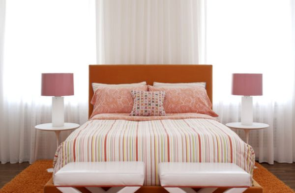 Beautiful strawberry pink and white coupled with orange in a contemporary bedroom