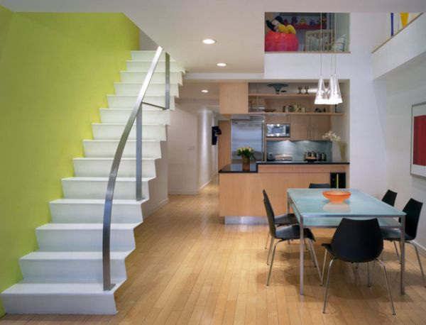 Beautiful yellow-green wall turns the staircase into stylish sculpture that draws attention instantly