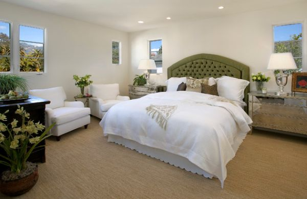 Bedroom with beautiful tufted headboard and plenty of natural green