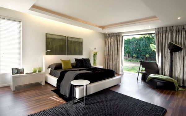 View in gallery Black and white bedroom with green fabric accents in green. Decorating With Green  52 Modern Interiors to Accentuate Freshness
