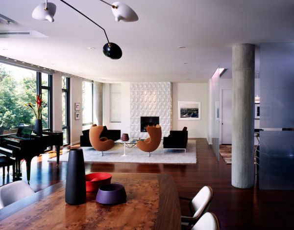 Black and white living room with Egg chairs that add a touch of color