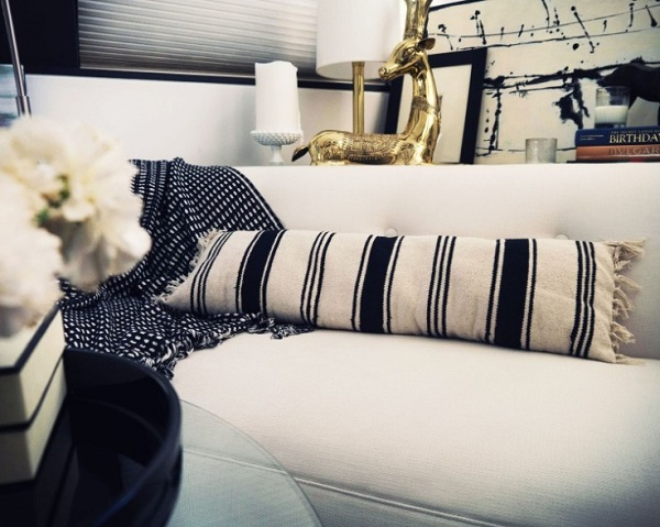 Blue and white striped pillow made out of rug