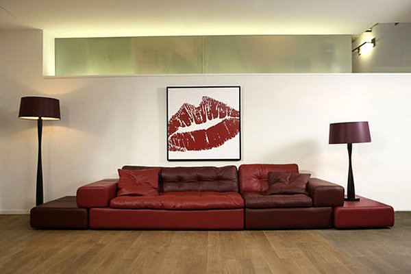 Bold red sofa and artwork