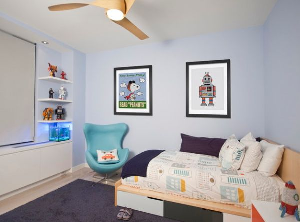 Boys' bedroom in blue incorporates an Egg chair that seems right at home