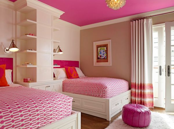Bunk beds and loads of pink grace this cool modern girls' bedroom
