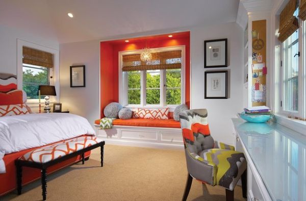 Bursts of orange in the bedroom create a playful vibe