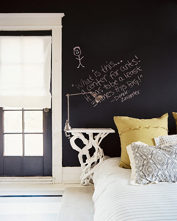 Chalkboard walls in a masculine bedroom