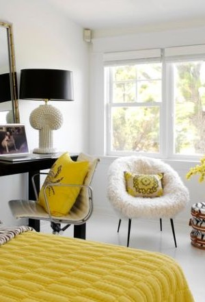 Chic bedroom employs yellow along with plush textures to create Hollywood Regency style