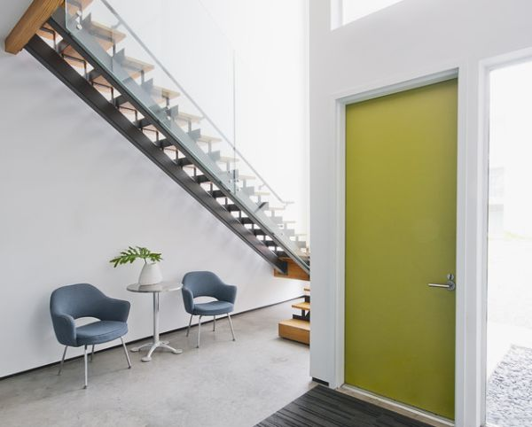 Chic entrance with greenish-yellow interior door