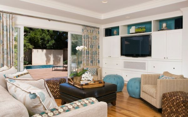 Colorful curtains and sliding glass doors separate the lively living room from the backyard