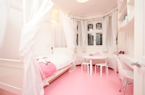 Contemporary girls' bedroom in pristine white and pretty pink
