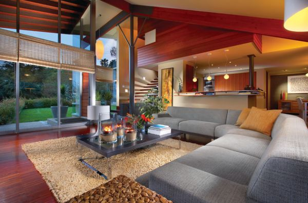 Contemporary living room with large glass windows and woven bamboo shades
