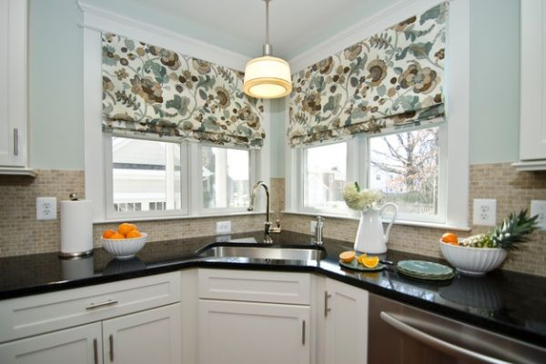 Control the amount of light you need while working at the corner sink with lovely curtains